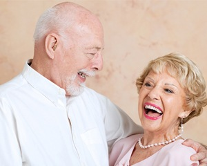 Older man and woman laughing together