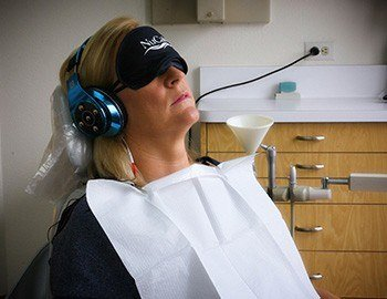 Patient with NuCalm face mask and headphones