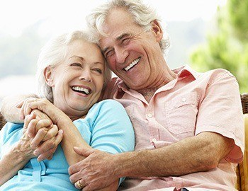 Smiling senior man and woman outdoors