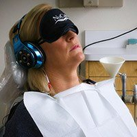 Patient with NuCalm facemask and headphones