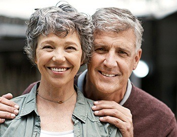 Senior man and woman smiling together